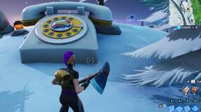 Image for Fortnite Season 10: search between a rotary phone, a fork knife and a hilltop house full of Carbide and Omega posters