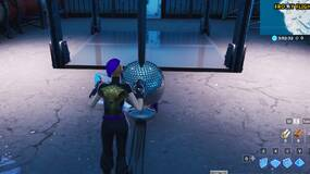 Image for Fortnite: dance with others to raise the disco ball in an icy airplane hangar