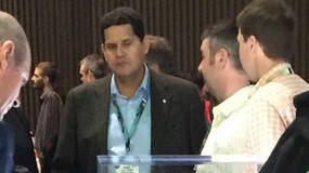 Image for Let's enjoy this incredible photo of Nintendo's Reggie Fils-Aime looking at the Xbox S